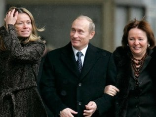 The Putin family. We think. The woman on the left is reported to be his daughter however it has never been confirmed. Photo: