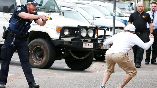 Police prepare to Taser a man in Cairns. Picture: Justin Brierty
