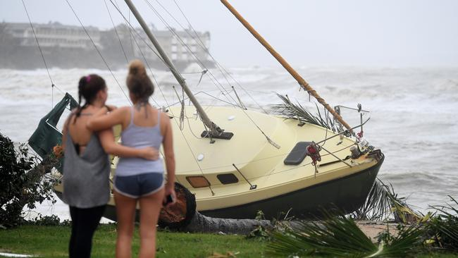 A boat washed ashore at Airlie Beach. Picture: AAP.