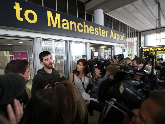 Ordeal...A passenger of the Qatar Airways flight from Doha are interviewed after their plane had a military escort into Manchester Airport. Picture: Getty