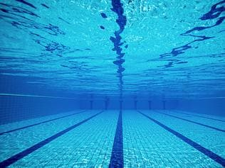 Swimming pool from underwater. Stock image