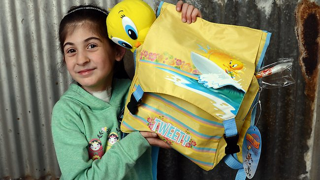 Angel, 8, says the Tweety backpack show bag is 'really fun', rating it a whopping 100 out of 10. Picture: Alex Coppel