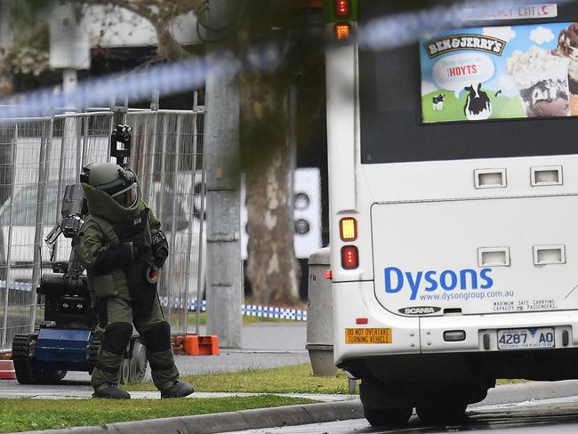 The bomb squad member checks the bus. Picture: AAP