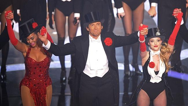 Oscar host Hugh Jackman dances with Beyoncé Knowles and Amanda Seyfried during his 2009 hosting gig.