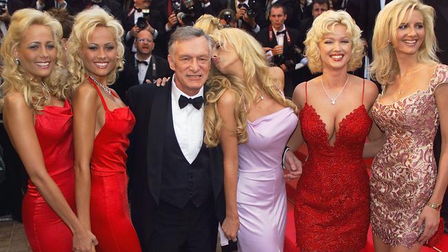 Playboy magazine president and founder Hugh Hefner poses with playmates on the steps of the Palais des Festivals before the screening of their movie 'Entrapment', in selection for the 52nd Cannes Film Festival in Cannes, 14/05/1999.