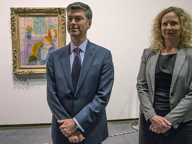 Obliged ... Tone Hansen (right), director of the Henie Onstad art gallery, and Christopher A Marinello, member of the Rosenberg family, pose in front of 'Woman in Blue in Front of a Fireplace' by Henri Matisse. Picture: Terje Bendiksby