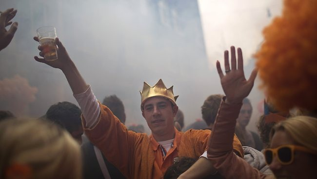 Hail to the king. People dance in the street in Amsterdam as they celebrate the coronation of King Willem-Alexander. (AP Photo/Emilio Morenatti)
