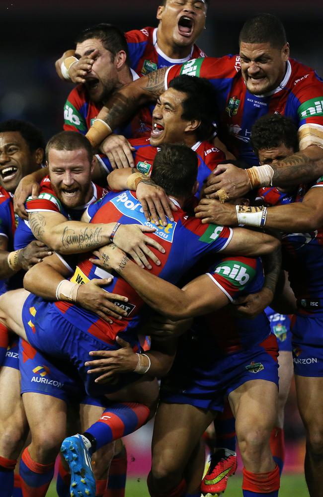 Kurt Gidley is mobbed by his teammates following the Knights' miracle win.