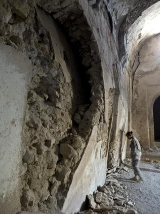 A US soldier walks inside St. Elijah's Monastery in Mosul, Iraq. Picture: Colonel Mary Prophit/US Army via AP