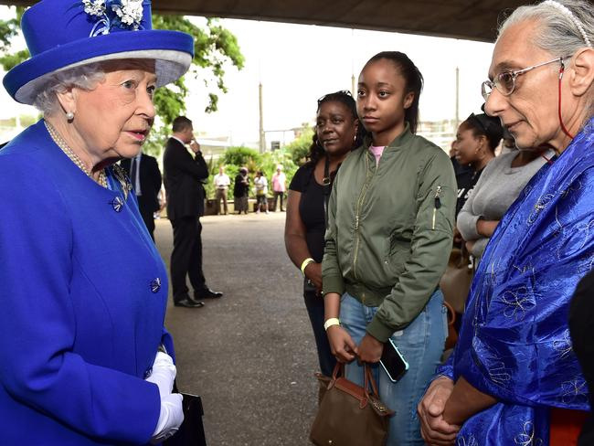 Queen Elizabeth II meets members of the community affected by the fire at Grenfell Tower in west London. Picture: Getty