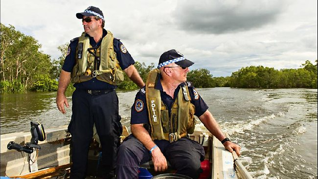Darwin water police Senior Constable Michael Wyatt and Senior Constable Eric Edgecombe search along Magela Creek. Picture: MICHAEL FRANCHI