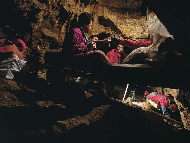 Dig ... palaeontologists unearth fossils at the Spanish cave site. Picture: Madrid Scientific Films