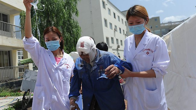 Nurses help an injured man at a temporary treatment station following an earthquake in Lushan county in Ya'an in southwest China's Sichuan province Saturday, April 20, 2013. The powerful earthquake shook Chinas Sichuan province Saturday morning, nearly five years after a devastating quake jolted the province. (AP Photo) CHINA OUT