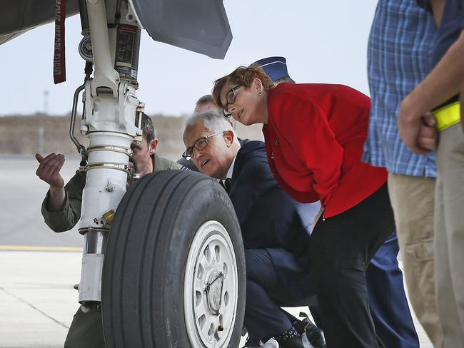Malcolm Turnbull and Defence Minister Marise Payne inspecting a new JSF on the tarmac at Avalon. Picture: David Caird