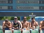 Spectators watch Carla Suarez Navarro of Spain play against Galina Voskoboeva of Kazakhstan.
