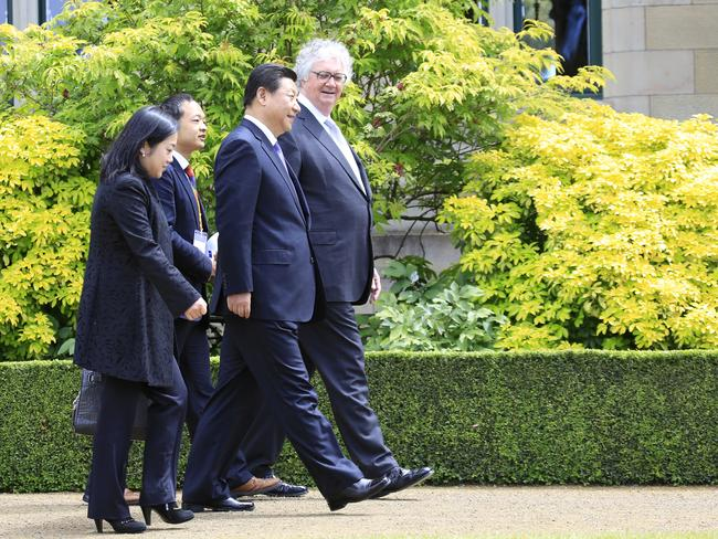 Chinese President Xi Jinping walks with the Lieutenant Governor of Tasmania, Justice Alan Blow, during a visit to Government House in Hobart, Tuesday, November 18, 2014.