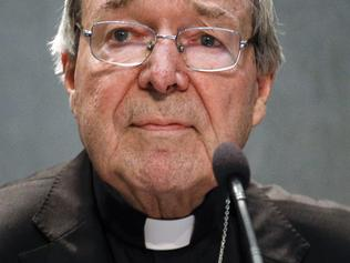 FILE - In this June 29, 2017 file photo, Cardinal George Pell meets the media, at the Vatican. The most senior Vatican cleric to ever be charged in the Roman Catholic Church sex abuse scandal returned to Australia on Monday,July 10, 2017 to stand trial in his home state on charges alleging he sexually assaulted multiple people years ago. (AP Photo/Gregorio Borgia, File)