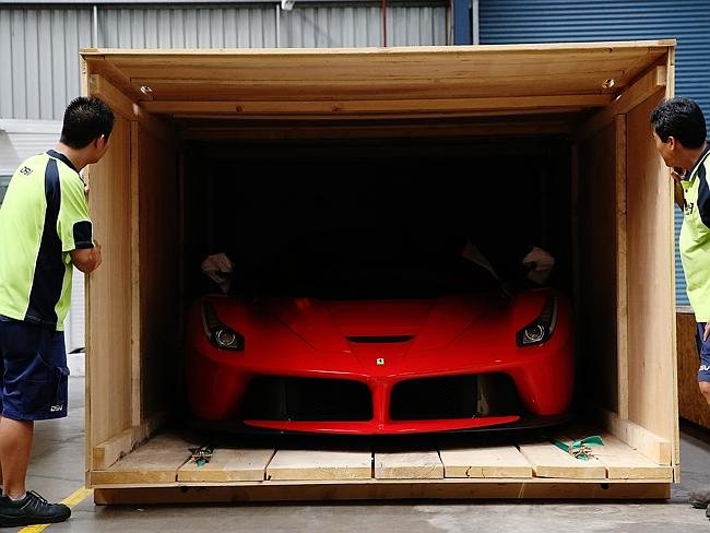 Here it comes ... The La Ferrari is unveiled from its shipping crate at Sydney Motorsport
