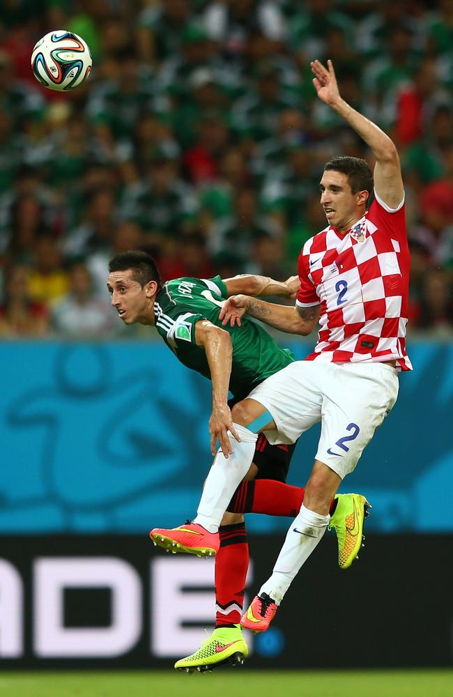 Hector Herrera of Mexico and Sime Vrsaljko of Croatia compete for a header.