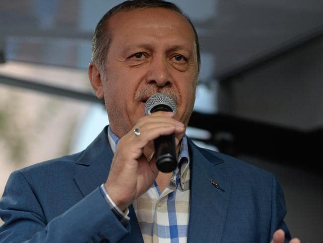 Turkish President Tayyip Erdogan delivers a speech to his supporters on Saturday. Picture: Defne Karadeniz/Getty Images