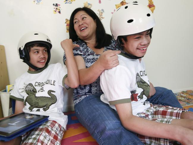 Miracles ... Arlene Aguirre, centre, plays with her formerly conjoined twin sons, Clarence, left, and Carl. Picture: AP