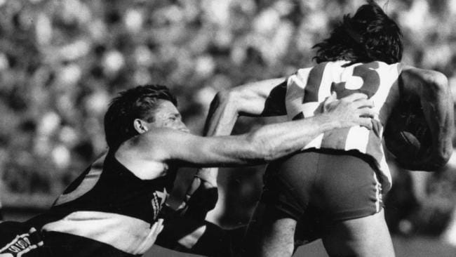Tony Antrobus shrugs clear of a Chris McDermott tackle in 1986.