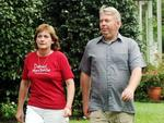 Denise wears a Daniel Morcombe Foundation T-shirt as she walks with her husband in February 2007. Picture: Graeme Parkes