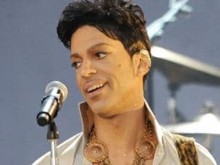 03/07/2011 WIRE: US singer Prince is performs on the main stage during The Hop Farm music festival, in Paddock Wood, Kent, on July 1, 2011. AFP PHOTO / Stuart Wilson Pic. Afp
