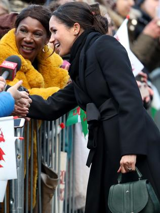 With all the hands Meghan Markle shakes it is no wonder she keep hand sanitiser in her bag. Picture: Getty