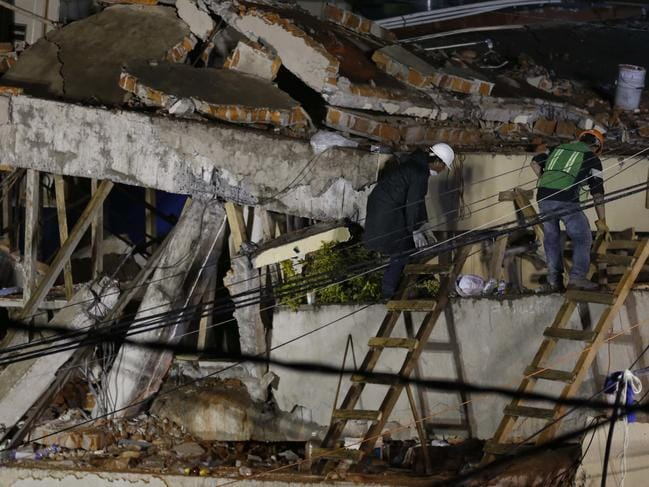 Rescue personnel work on the Enrique Rebsamen primary school, that collapsed after an earthquake, in Mexico City, Sept. 20, 2017. A wing of the school collapsed during the quake killing scores of young children. (AP Photo/Marco Ugarte)