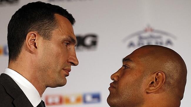 Wladimir Klitschko, and Alex Leapai stare down after a press conference ahead of their IB