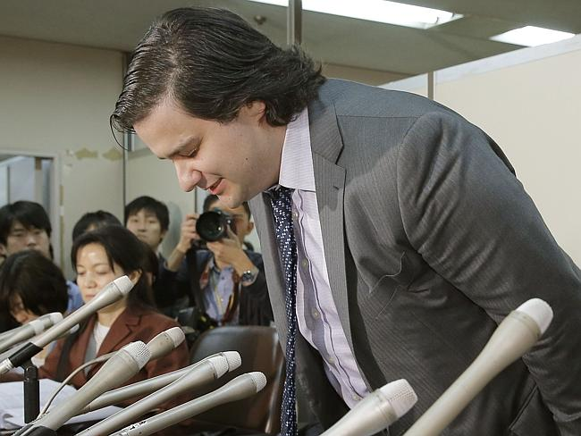 Crisis management ... MtGox CEO Mark Karpeles bows in apology after filing for bankruptcy protection.