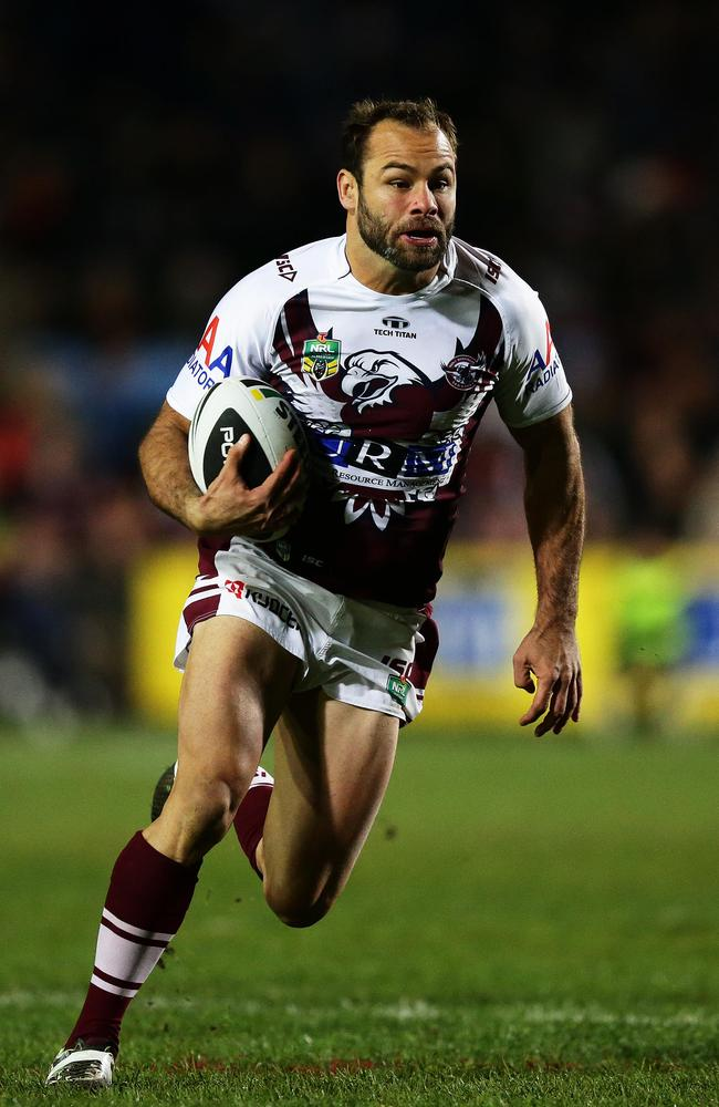 Manly's Brett Stewart makes a break to set up a try by Manly's Peta Hiku.