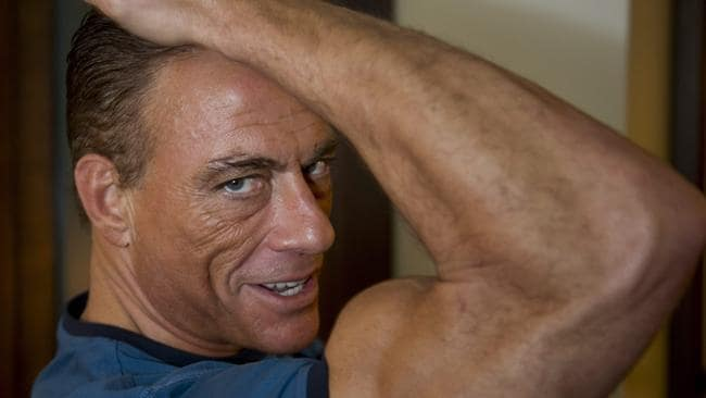 Belgian actor Jean-Claude van Damme flexes his muscles. AP Photo/The Canadian Press, Paul Chiasson