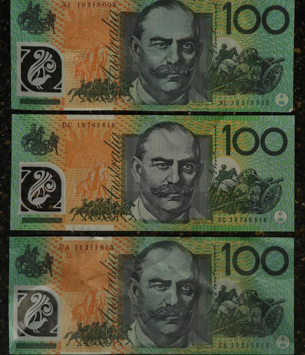 Spot the real hundred dollar note. Only one is real, the others were used by a patron using fake $100 notes to buy drinks, at a bar in Surfers Paradise. Picture: Glenn Hampson