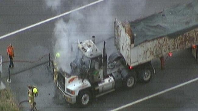 The fire-damaged truck on the Monash Freeway. Picture: Emma Notarfrancesco/Twitter
