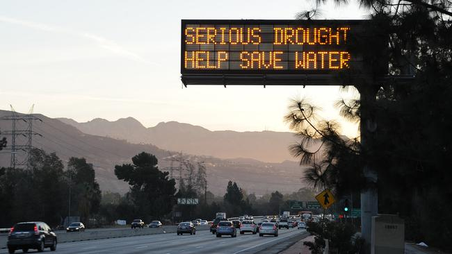 A sign over a highway in Glendale, California warns motorists to save water in response to the state's severe drought. Picture: Robyn Beck/AFP/Getty Images