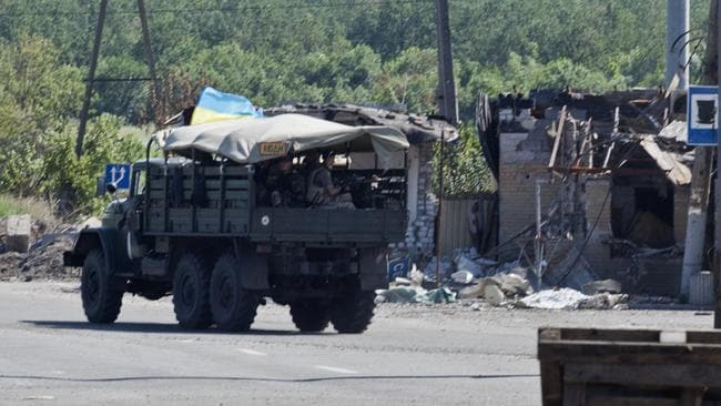 Pushing back the separatists ... a Ukrainian vehicle at the Sloviansk battlefield. Picture: Ella Pellegrini
