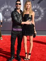 Adam Levine, left, and Behati Prinsloo arrive at the MTV Video Music Awards. Picture: AP