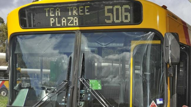 A picture of the top front of a yellow Adelaide Metro bus - reading Tea Tree Plaza 506.