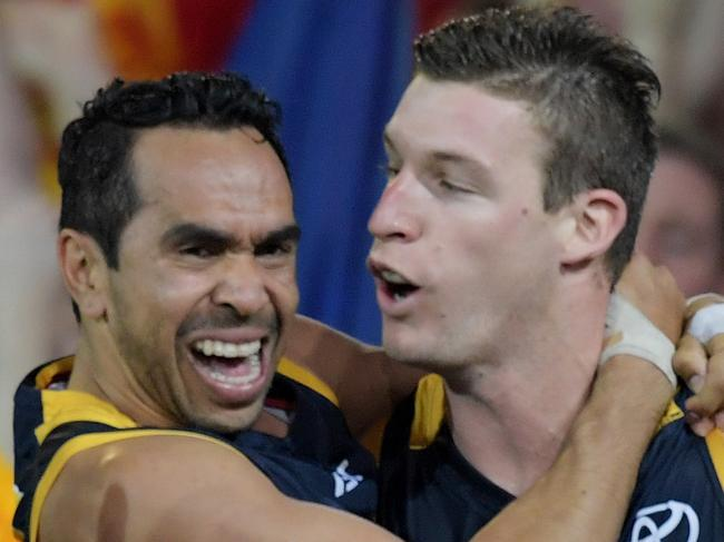 Eddie Betts of the Crows jumps on Josh Jenkins of the Crows as he celebrates a goal during the Adelaide Crows and Geelong Cats Men's AFL First Preliminary Final at the Adelaide Oval in Adelaide, Friday, September 22, 2017. (AAP Image/Tracey Nearmy) NO ARCHIVING, EDITORIAL USE ONLY
