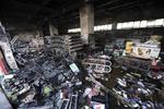 <p>A supermarket burnt out during riots in Urumqi. Picture: AP</p>
