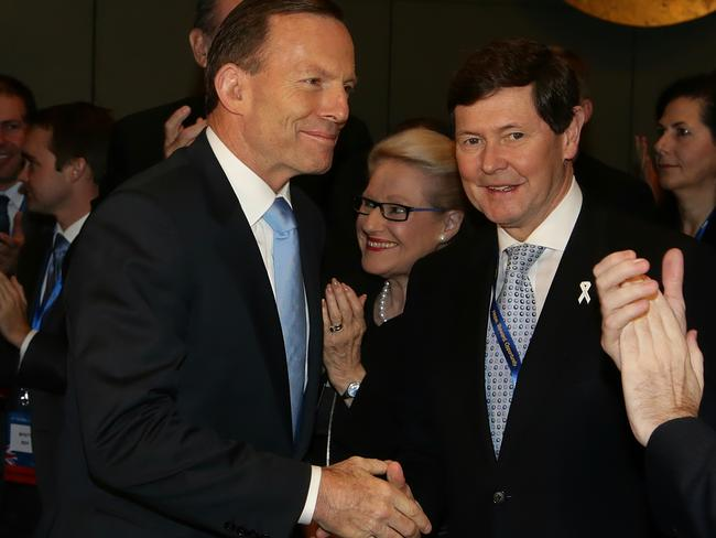 Prime Minister Tony Abbott greets Kevin Andrews as he prepares to speak during the Liberal Party's 57th Federal Council in Melbourne. Picture: Hamish Blair