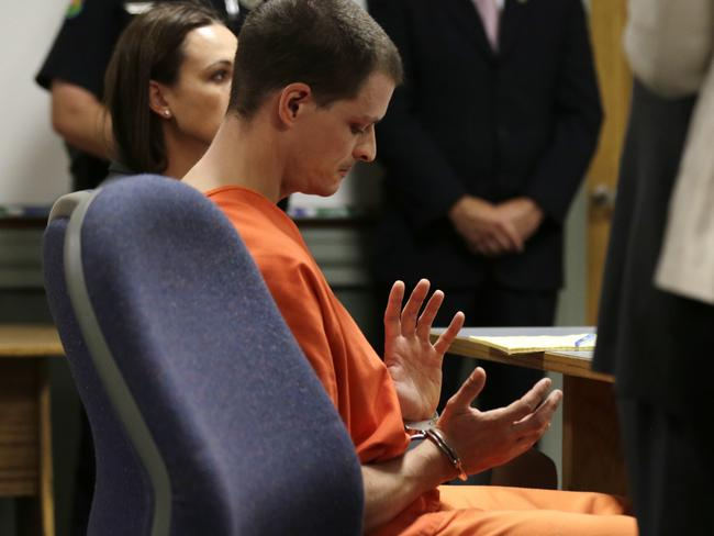 Not going anywhere ... Kibby looks down at his handcuffs as he is arraignment at Conway District Court. Picture: AP