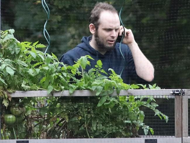 Freed Canadian hostage Joshua Boyle talks on the phone outside the Boyle family home in Ontario, Canada. Picture: AFP Photo/Mike Carroccetto