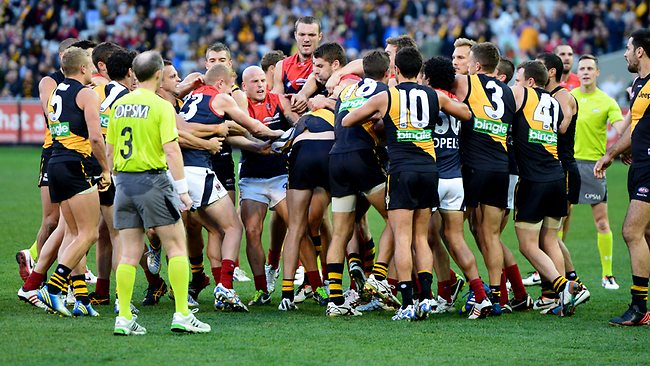 Players guarantee the AFL coffers will be overflowing this week from fine payments as the Dees and the Tigers become involved in a halftime melee. Picture: Wayne Ludbey