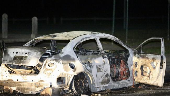 A burnt-out car is being investigated in relation to the shooting. Picture: NewsCorp Australia.