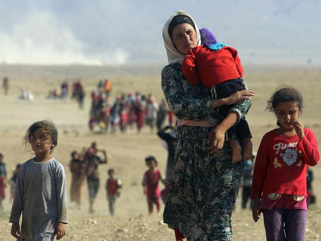 Men, women and children from the minority Yazidi sect being systematically slaughtered by the Islamic State of Iraq and Syria try and escape. Picture: Reuters