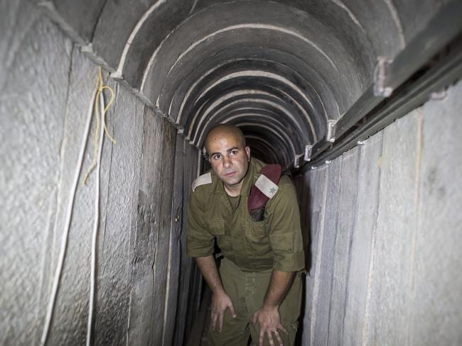 An Israeli soldier inside a Hamas Terror tunnel leading from the Gaza Strip into Southern Israel during 2014's Operation Protective Edge. Picture: Picture: Ilia Yefimovich/Getty Images