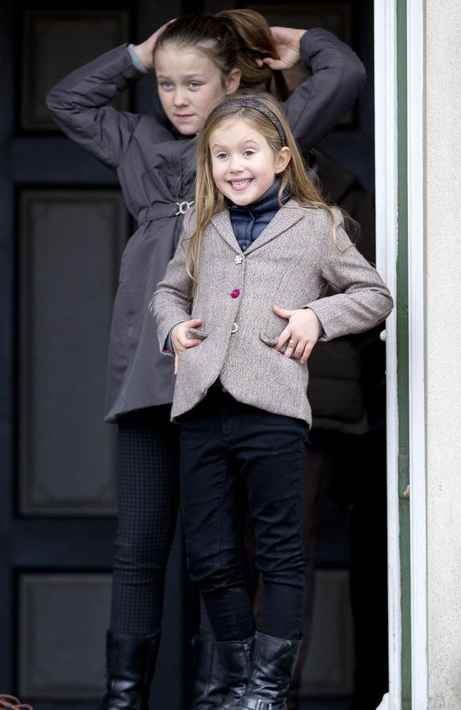 Mary's daughters Isabella and Josephine ham it up for the cameras. Picture: Splash News